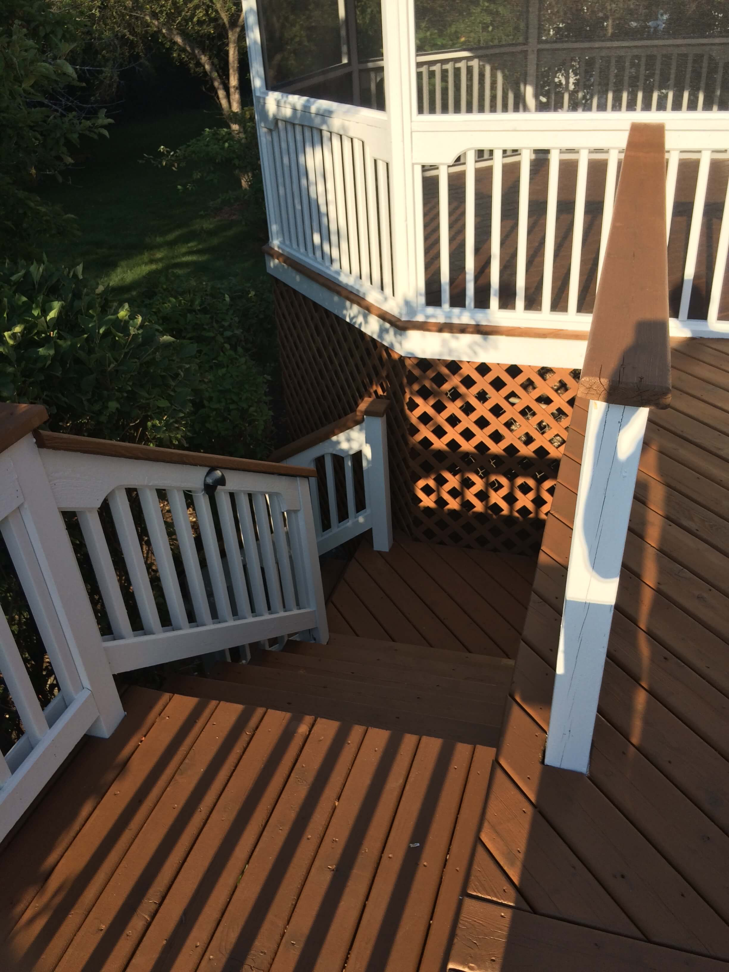 Stairs and screened in gazebo that have been recently painted.