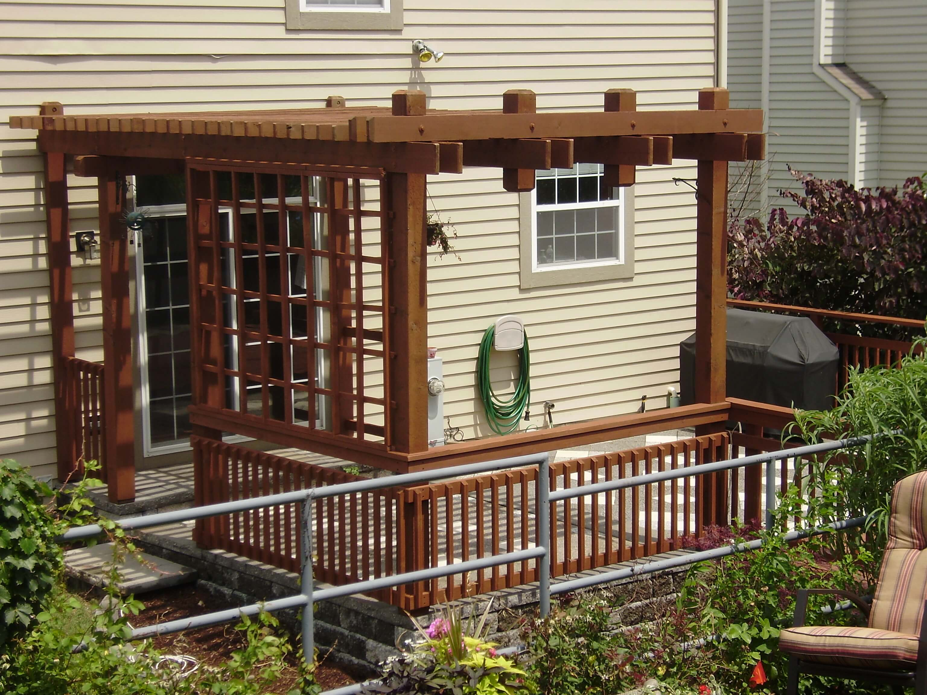 Outdoor deck and pergola that was recently treated with a transparent cedar bark stain.