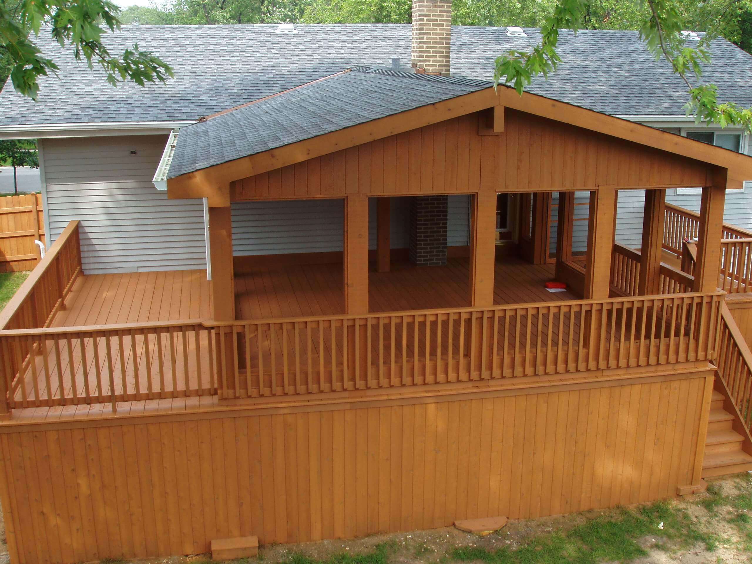 Large outdoor entertainment space that was recently treated with a transparent cedar stain.