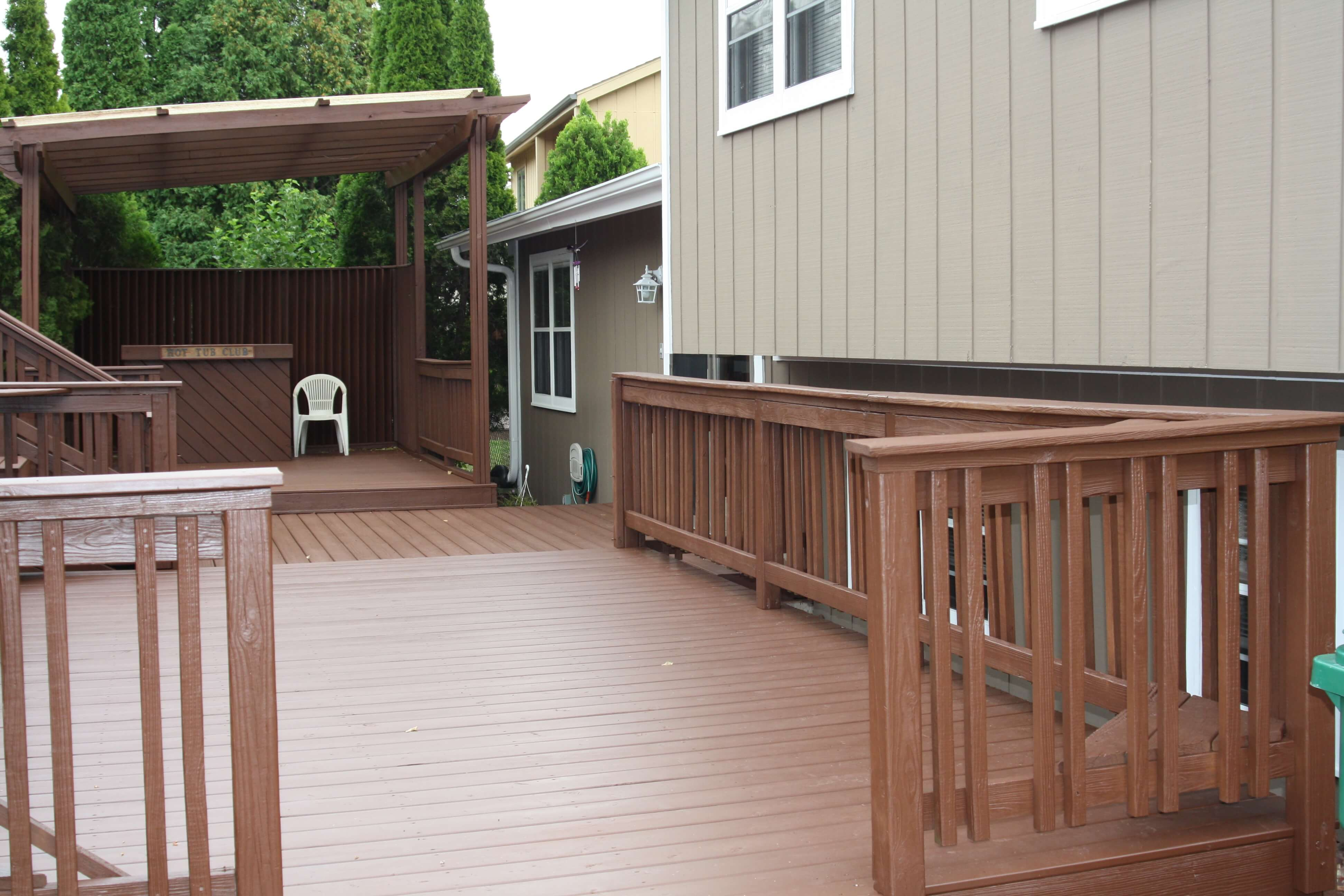 Deck on the back of the house that was recently stained with a dard semi transparent stain.