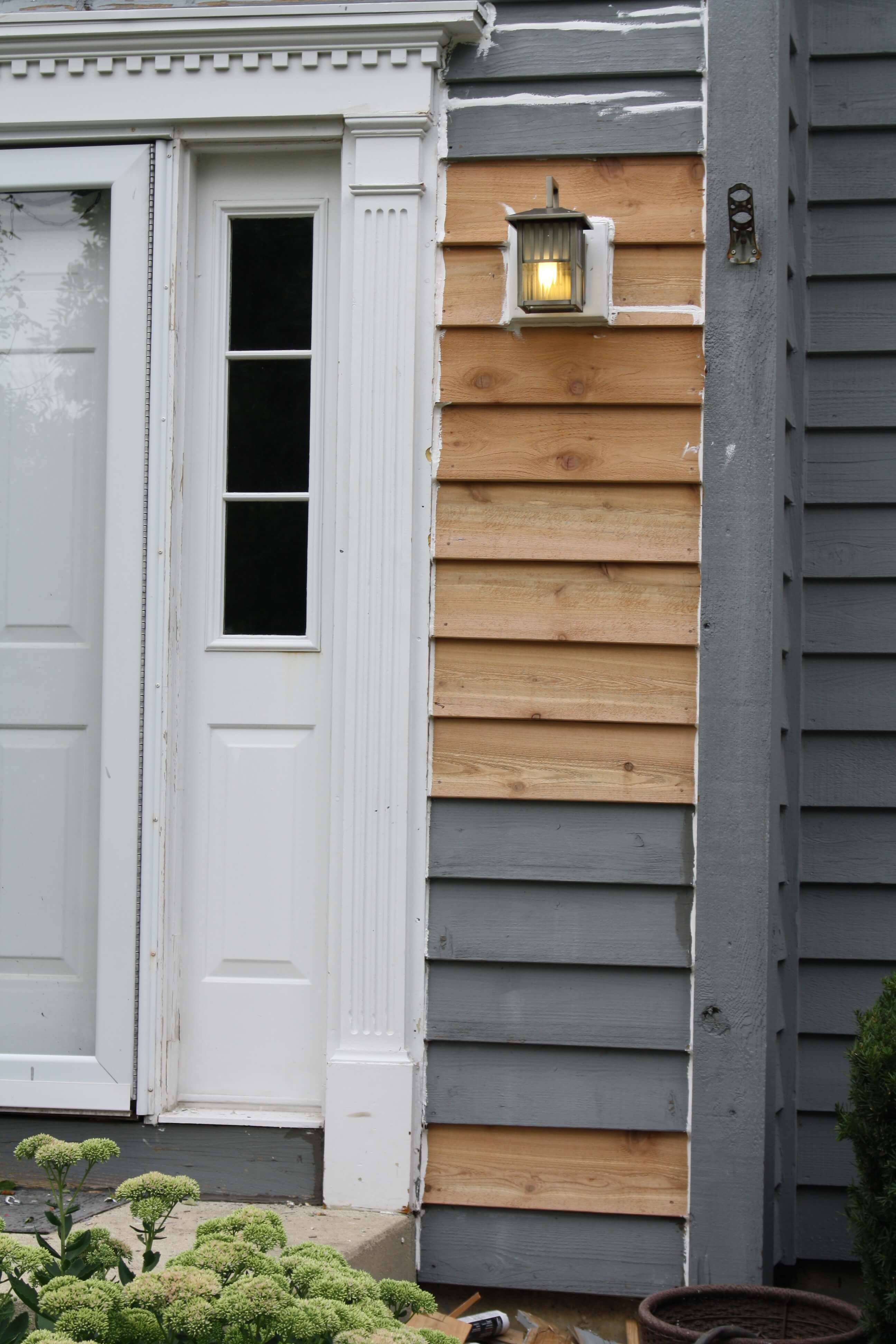 Front entryway with recently replaced cedar siding