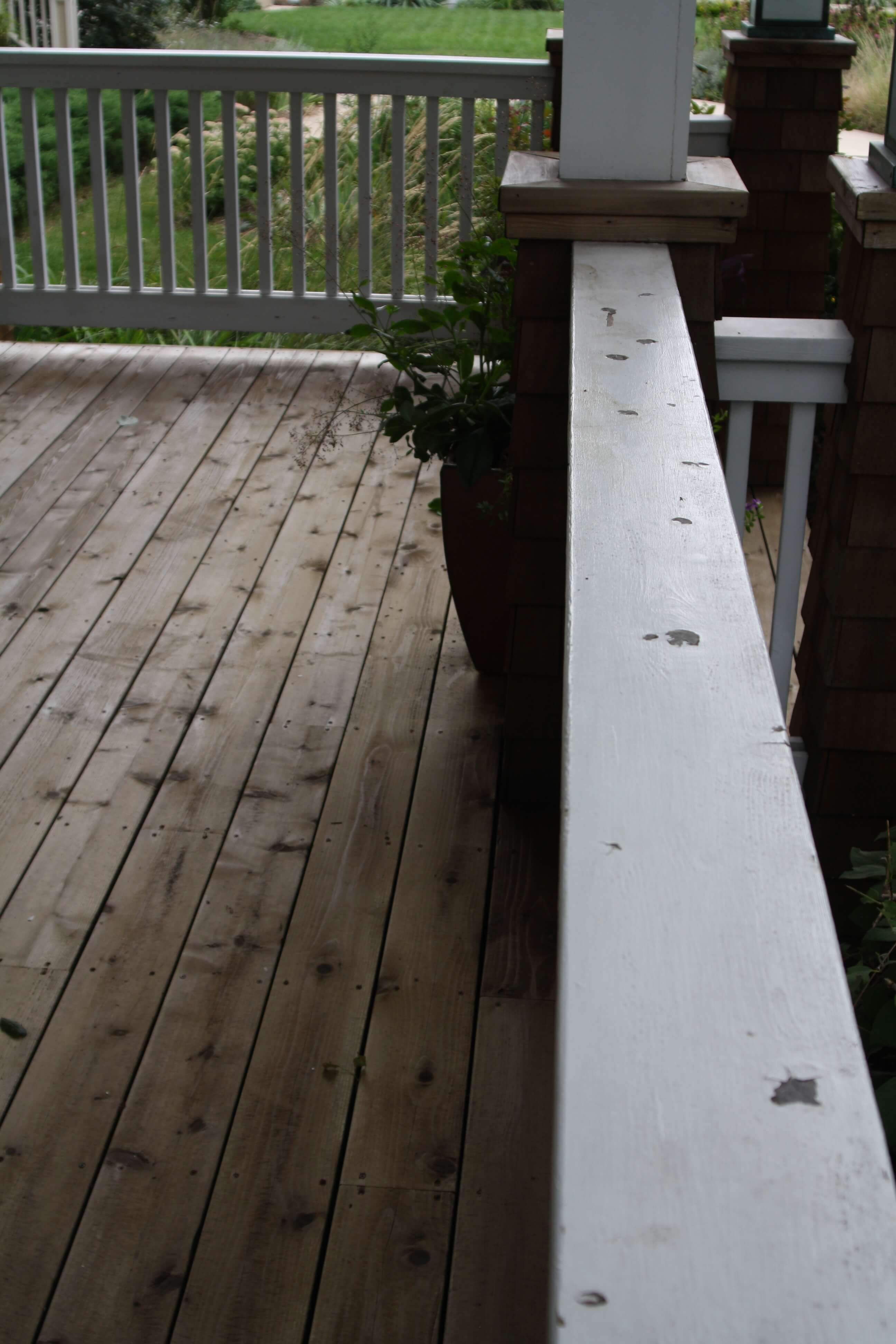Cedar porch floor with railings