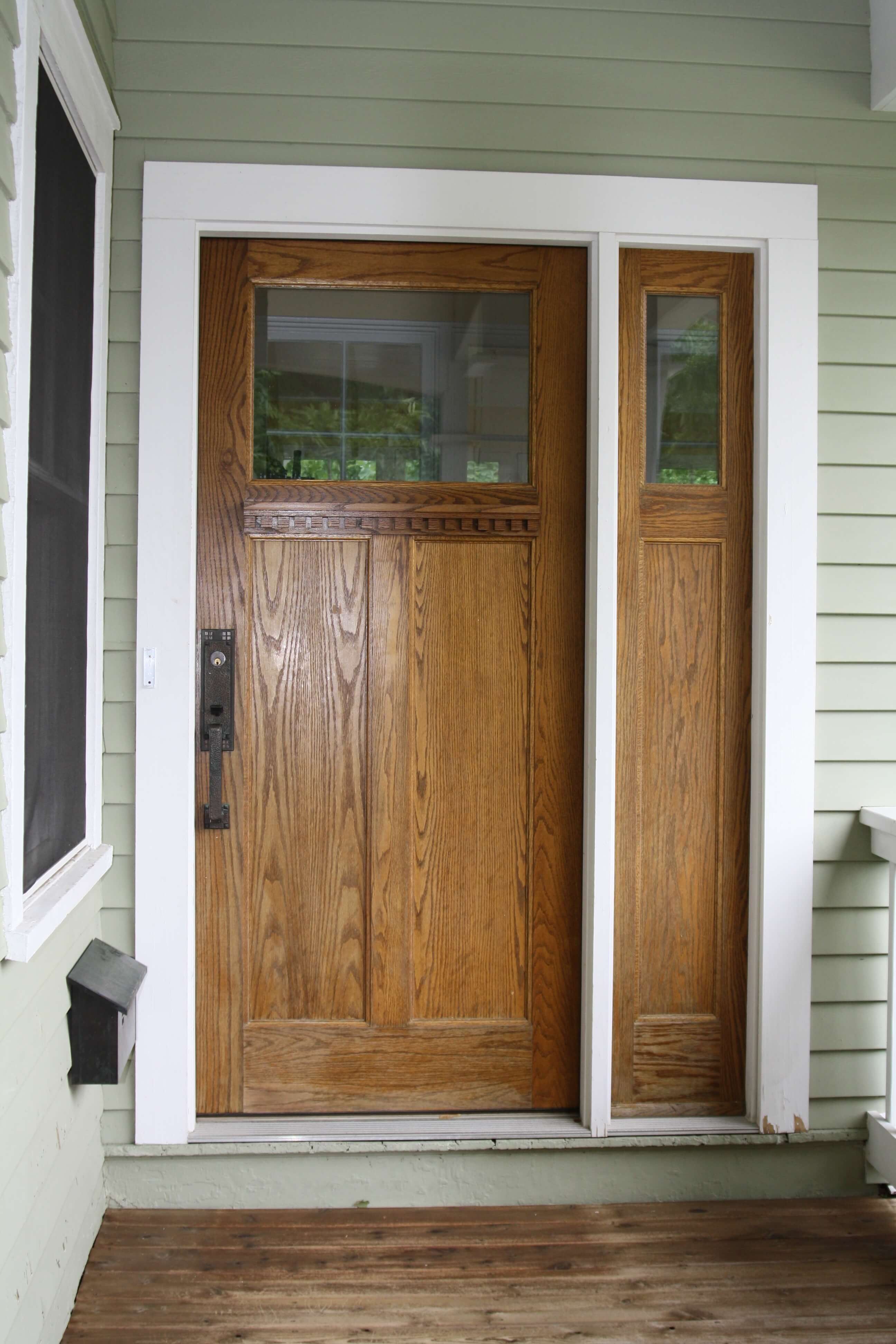 Wood entry doors in the front of a house