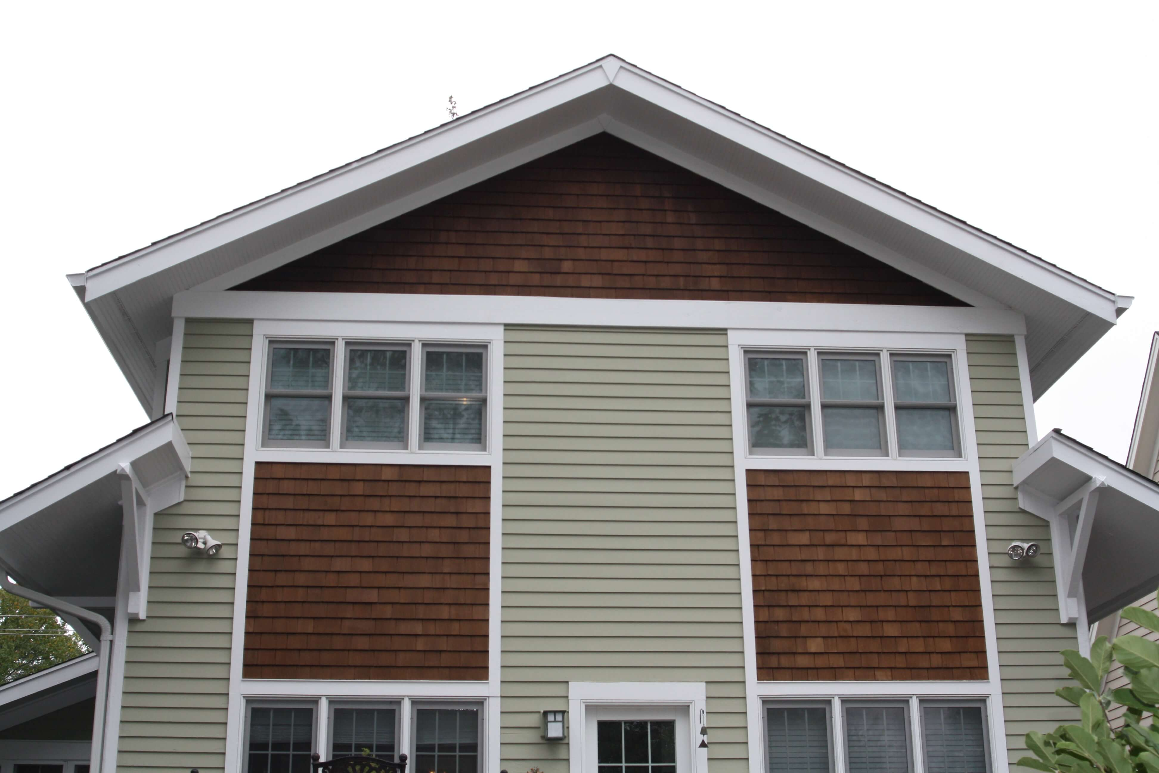 Recently painted house green with cedar shake accents
